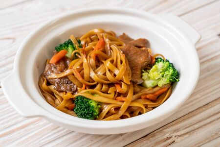 stir-fried noodles with pork and vegetable - Asian food style Banco de Imagens