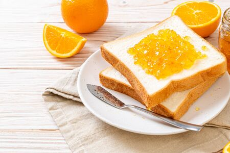 Slices of bread with orange jam for breakfast