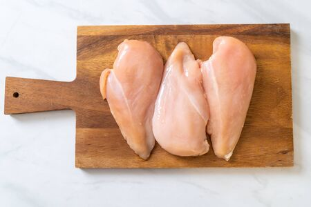 fresh chicken breast raw on cutting board Stok Fotoğraf