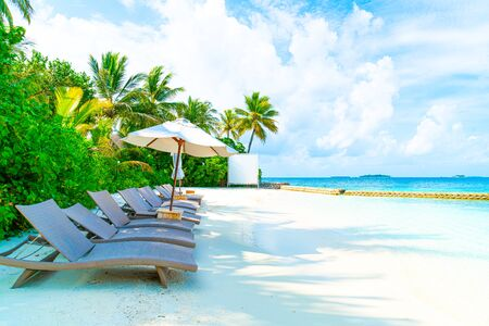 beach chair with tropical Maldives resort hotel island and sea background Imagens