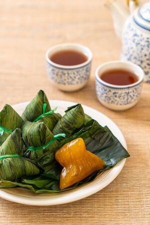 Zongzi or Traditional Chinese Sticky Rice Dumplings - Asian food style