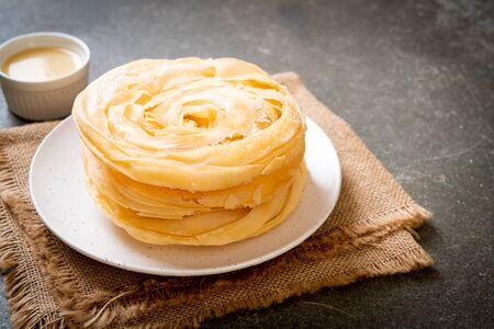 fried crispy roti dough with sweetened condensed milk Stock Photo