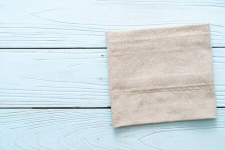 kitchen cloth (napkin) on blue wooden background with copy space Stockfoto