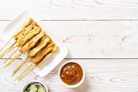 Pork satay - Grilled pork served with peanut sauce or sweet and sour sauce - Asian food style