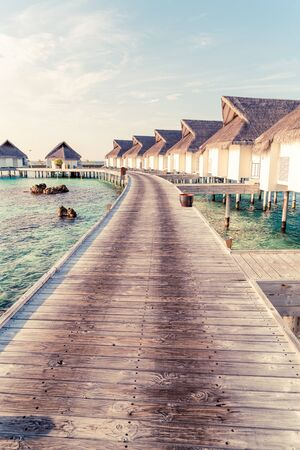 Beautiful tropical Maldives resort hotel and island with beach and sea  - boost up color processing style Фото со стока