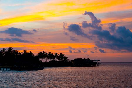 beautiful sunset sky with Maldives Island