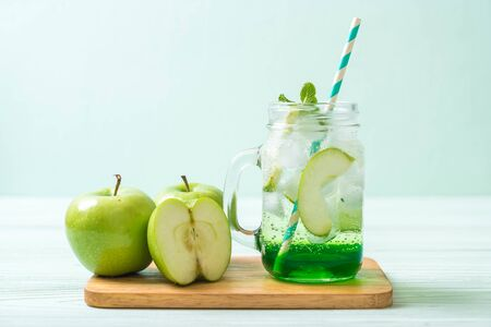 green apple soda on wood table
