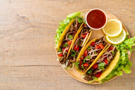tacos with meat and vegetables  -  Mexican food style Imagens