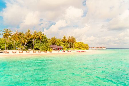 Beautiful tropical Maldives resort hotel and island with beach and sea - boost up color processing style Reklamní fotografie