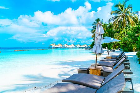 beach chair with tropical Maldives resort hotel island and sea background Standard-Bild