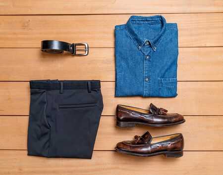 Beautiful casual men fashion and clothes set on wood background