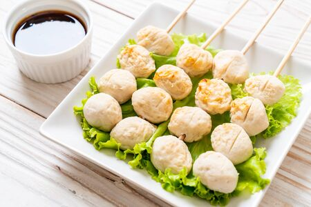 grilled pork meatballs with sweet chili sauce on plate Stockfoto