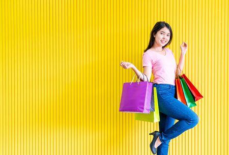 Asian women shopping addicted holding shopping bags