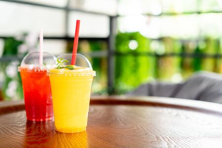 mango smoothies glass in cafe restaurant Stock Photo