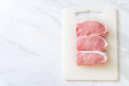 fresh pork raw on cutting board 스톡 콘텐츠