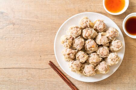 Pork dumplings with sauce - Asian food style