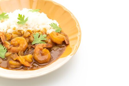 Shrimps in curry sauce on topped rice isolated on white background