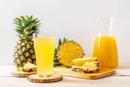 fresh pineapple juice on wood background
