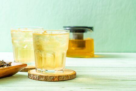 iced jasmine tea on wood background Imagens