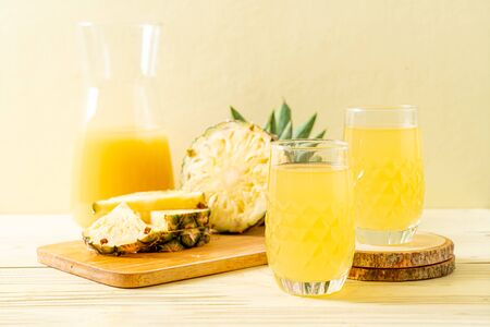 fresh pineapple juice on wood background