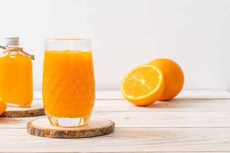 fresh orange juice glass on wood background