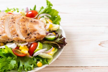 Healthy salad bowl with chicken - healthy food style