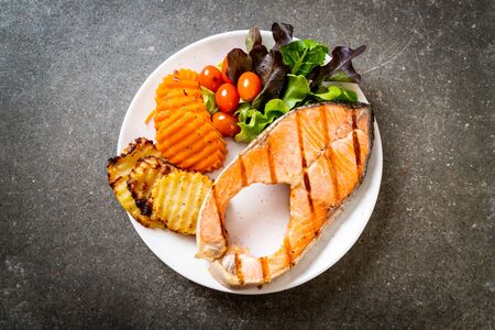 grilled salmon steak fillet with vegetable on plate