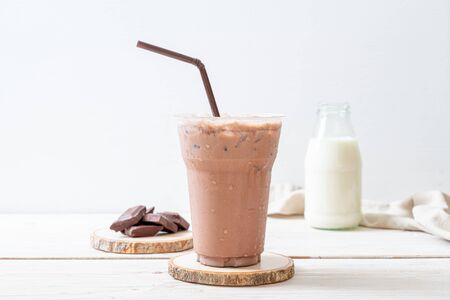 Iced chocolate milkshake drink on wood background