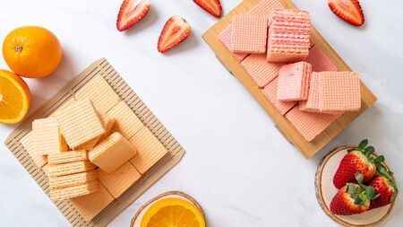 wafer with orange cream and strawberry cream flavour