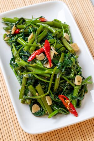 Stir-Fried Chinese Morning Glory or Water Spinach - Asian food style Foto de archivo - 129253249