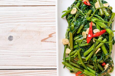 Stir-Fried Chinese Morning Glory or Water Spinach - Asian food style Фото со стока