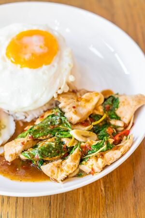 Basil Fried Chicken and fried egg with rice - Thai local food style