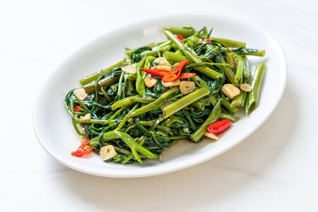 Stir-Fried Chinese Morning Glory or Water Spinach - Asian food style Reklamní fotografie