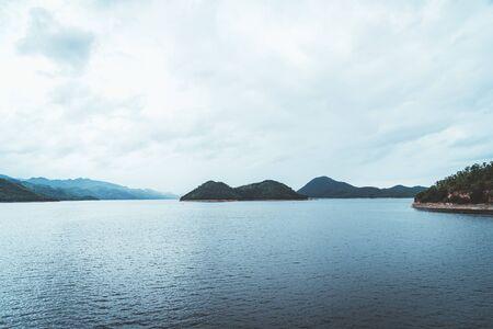Nature scene of Srinagarind Dam with cloudy sky at kanchanaburi ,Thailand