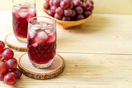 fresh grape juice on wood background