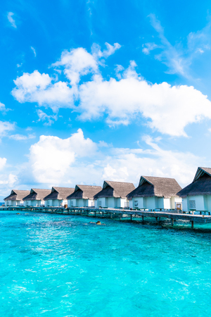 tropical Maldives resort hotel and island with beach and sea for holiday vacation concept - boost up color processing style Banque d'images - 128356001