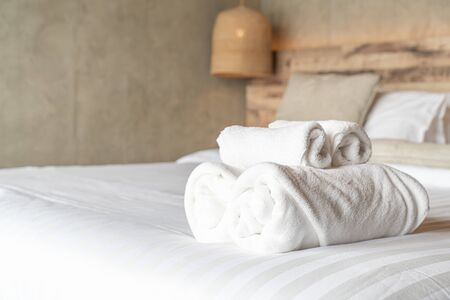 White towel on bed decoration in bedroom interior