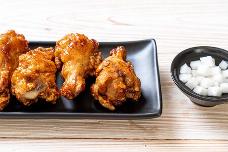 Fried chicken with sauce in Korean style Stock Photo - 128757702