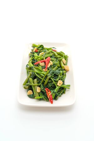 Stir-Fried Chinese Morning Glory or Water Spinach isolated on white background 스톡 콘텐츠