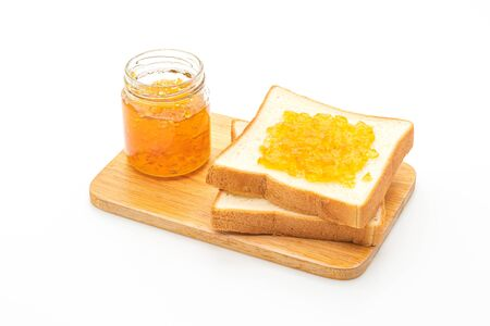 Slices of bread with orange jam isolated on white background