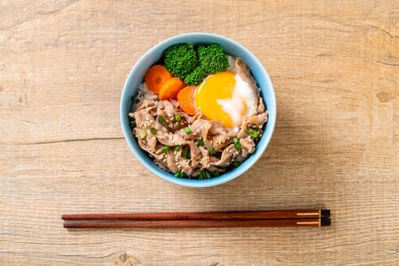 donburi, pork rice bowl with onsen egg and vegetable - japanese food style