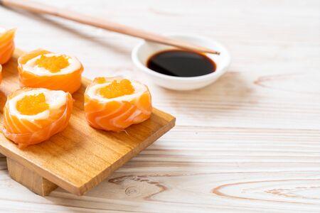fresh salmon sushi roll with mayonnaise and shrimp egg - Japanese food style
