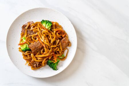 stir-fried noodles with pork and vegetable - Asian food style Banco de Imagens