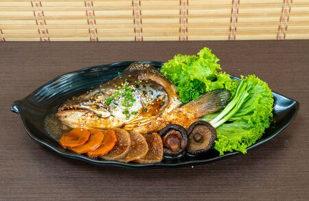 steamed Salmon fish head soup with soy sauce. - Japanese food style