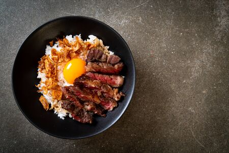 sliced beef on topped rice bowl with egg - Japanese food style