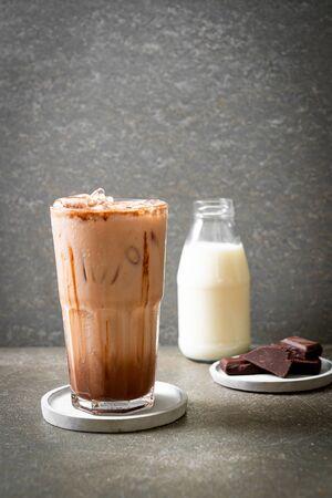 Iced chocolate milkshake drink on wood background