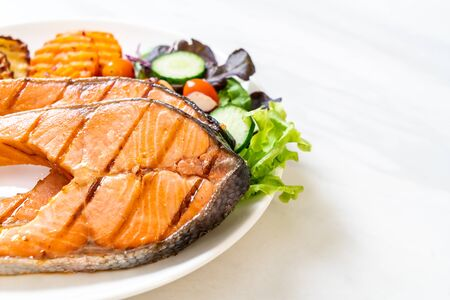 double grilled salmon steak fillet with vegetable