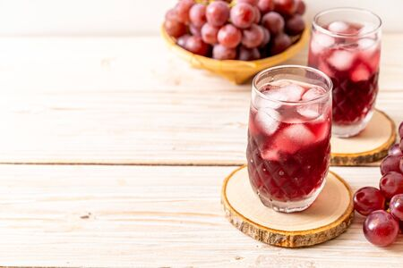 fresh grape juice on wood background