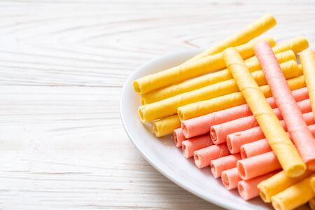 colorful wafer stick roll with cream Imagens