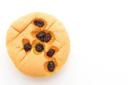 sponge cup cake with raisin isolated on white background
